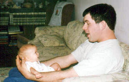 Young Man with Baby Girl